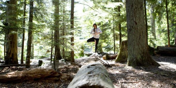 Holding a yoga balance pose in Rebagliati Park, Whistler.