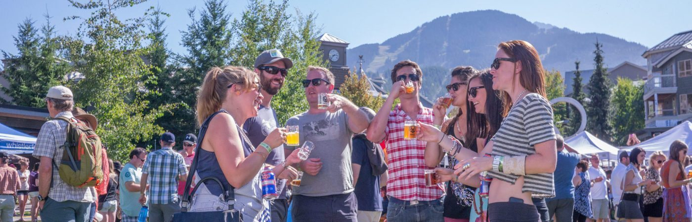 Partiers enjoying Whistler Village Beer Festival activities.